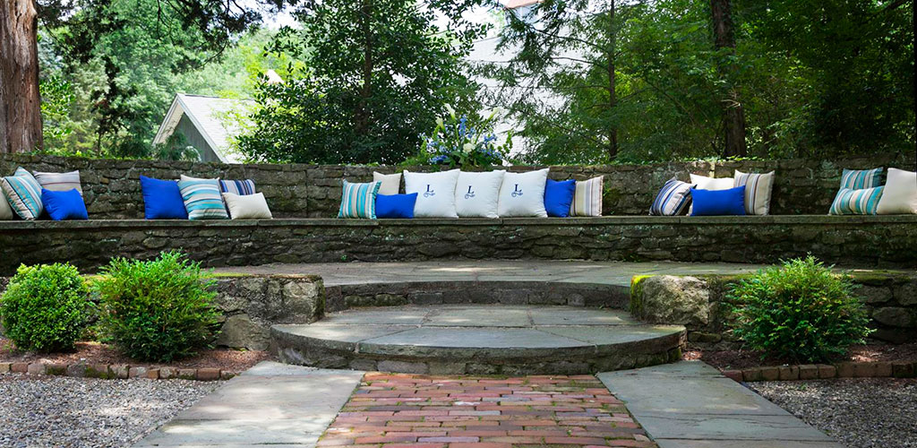 SLIDER-holly-hedge-wedding-venue-brick-terrace-stone-courtyard-chic-pillow-decor-romantic-rustic1
