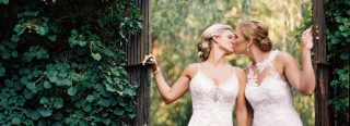 Brides Kissing by the Gate